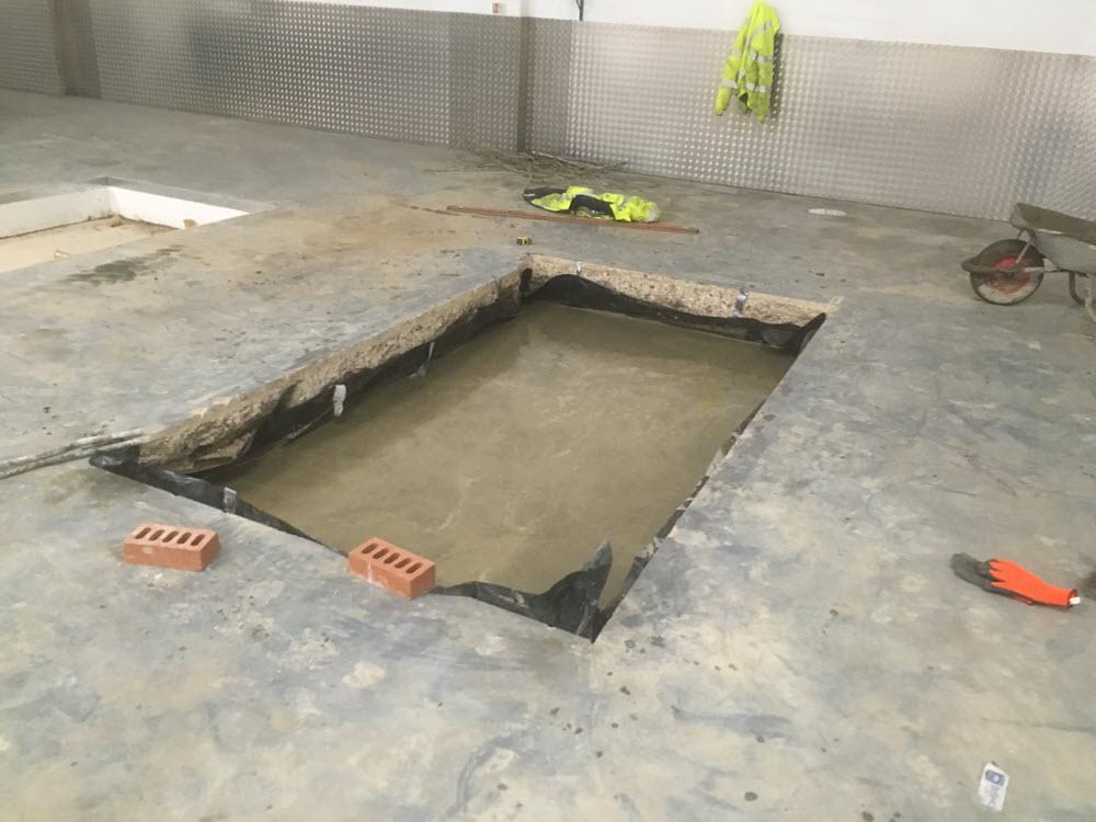 break reinforced concrete floor, pour base for new pit, Newmarket